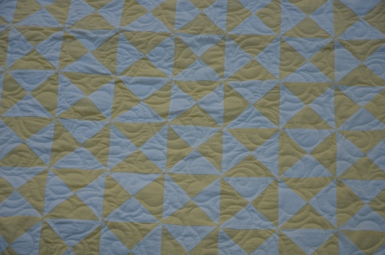 Yvonne 's vintage baby broken dishes/hourglass quilt top.